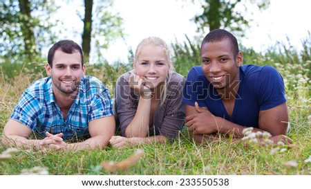 Three young people spending time outside - stock photo
