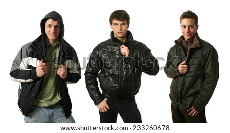 Three young sexy men in winter clothes isolated on white - stock photo