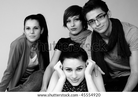 three young woman and one boy - stock photo