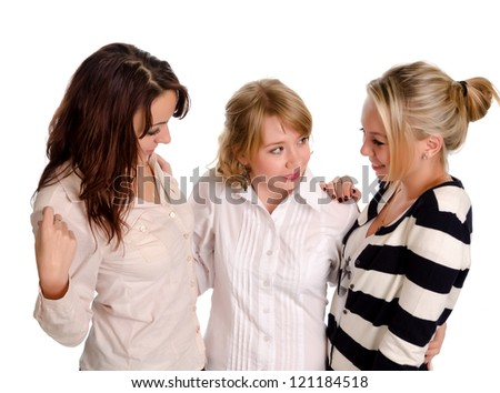 Three young woman friends standing close together with their arms around each others shoulders chatting and smiling isolated on white - stock photo