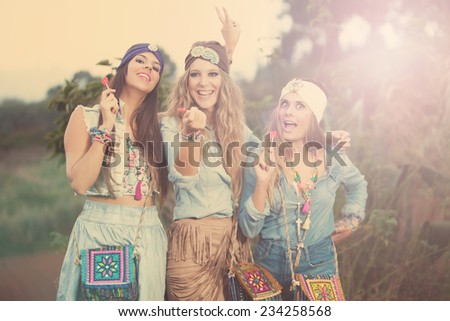 three young woman making selfie with lollipop in park - stock photo