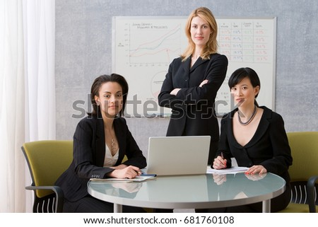 Three young women conference room