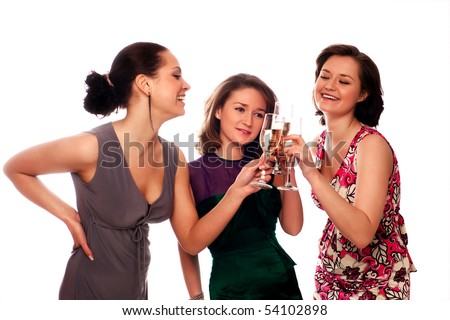 Three Young Women Enjoying Champagne At A Party - stock photo