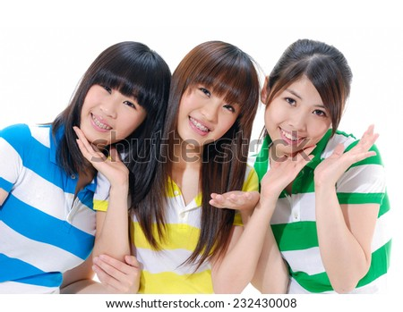 Three young women having a good time chatting and laughing - stock photo