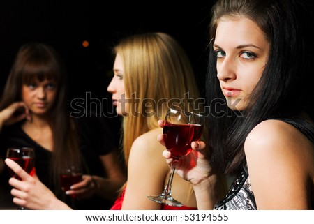 Three young women in a bar.