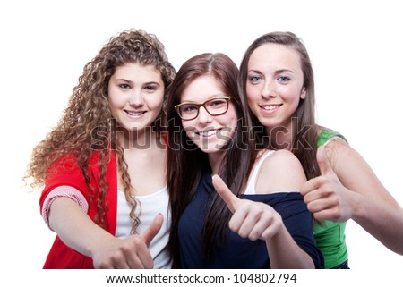 Three young women isolated over pure white background. - stock photo