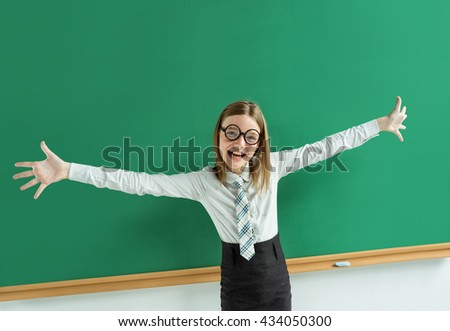 Thrilled pupil raise her palms up. Photo of teen school girl wearing glasses, creative concept with Back to school theme - stock photo