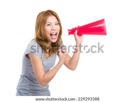 Thrilled woman shout with megaphone - stock photo