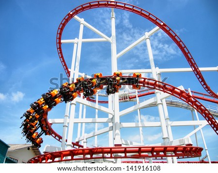 Thrills for riders of the roller coaster. - stock photo