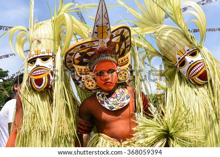 THRIPPUNITHURA, INDIA - SEPT 11: Men dressed as traditional dancers. The famous colorful tribal/ mask-dance during the festival of Onam. September 11, 2015 in Thrippunithura, Kerala,India. - stock photo