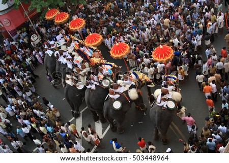 THRISSUR, INDIA - APRIL 24 : Decorated elephants being paraded  during the Pooram festival in April 24, 2010 in Thrissur, Kerala, India.Thrissur Pooram is the most popular elephant festival in India.