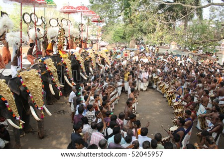 THRISSUR, INDIA - APRIL 24 : Gold caparisoned elephants and percussion in Pooram Festival April 24, 2010 in Thrissur, Kerala, India.