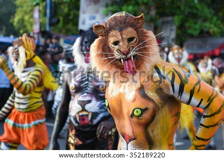 THRISSUR, INDIA - SEPT 28: Body painted artists perform at Swaraj round on September 28, 2015 in Thrissur, Kerala,India. Tiger dance is a traditional folk art performed during Onam. - stock photo