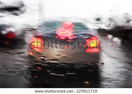 Through a car windshield during rain storm - stock photo