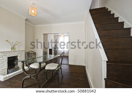 through dining room with hard wood floor and staircase - stock photo