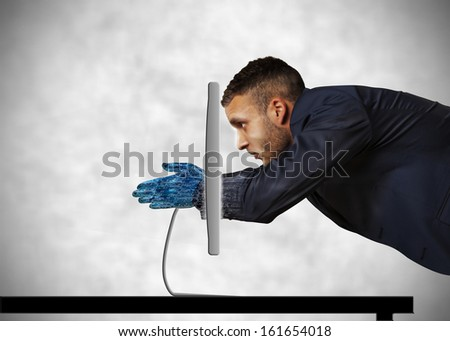 through the technology with big lcd monitor - stock photo