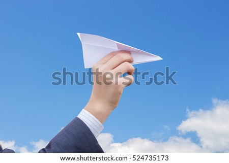 Throwing a paper plane. Freedom, success business concepts .