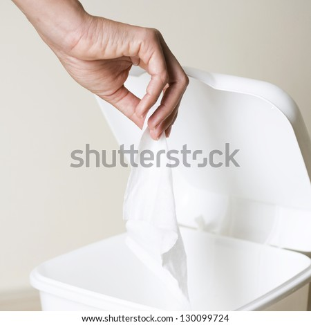 throwing away a tissue - stock photo