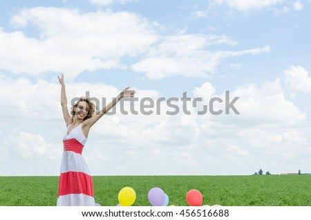 throwing balloons in the air - stock photo