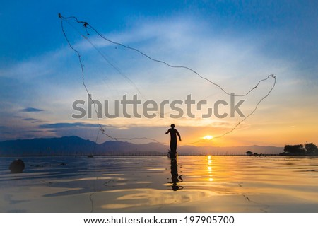 throwing fishing silhouette sunset - stock photo
