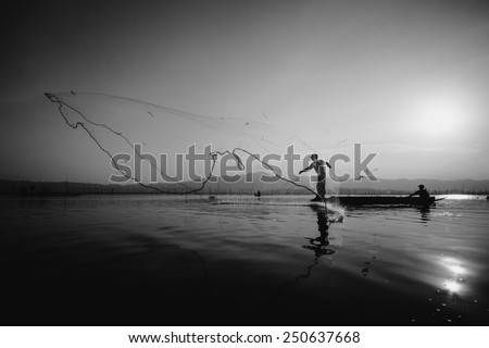 throwing fishing silhouette tone black&white   - stock photo