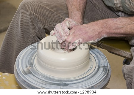 Throwing pottery 1 - stock photo