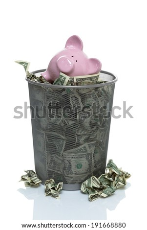 throwing your savings away in the garbage - stock photo