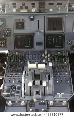 thrust levers of a twin engined airliner