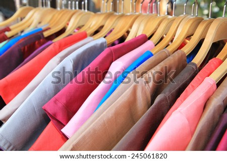 Thsi silk clothes on hangers - stock photo