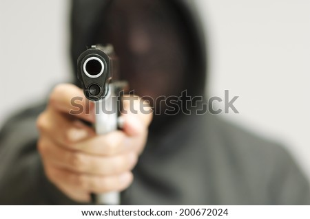 Thug with a Gun - stock photo