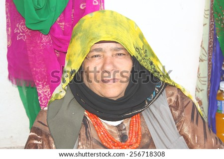 THULA, YEMEN - DECEMBER 2009: unidentified woman who looks forward to be photographed by tourists on December 01, 2009 in Thula. Yemenis are happy when tourists make photos from them. - stock photo