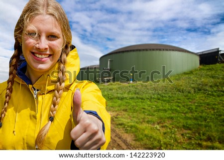 Thumb up for bio gas - stock photo