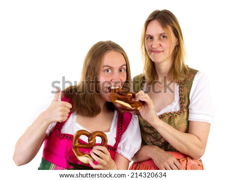 Thumb up for delicious oktoberfest pretzel - stock photo
