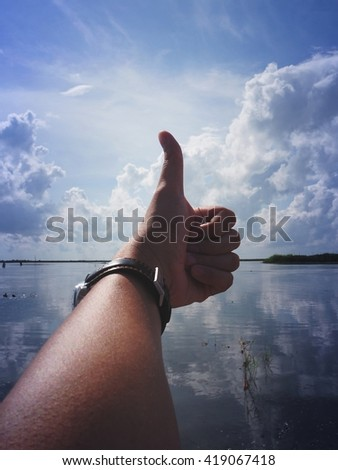 Thumb up for great nature, silhouette - stock photo