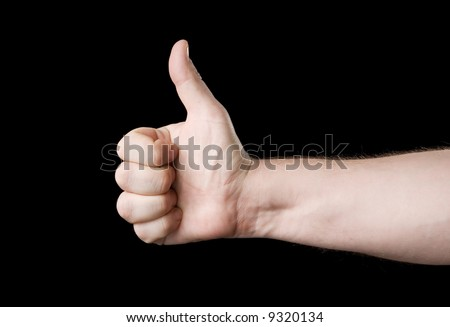 Thumb up. Isolated on a black background.