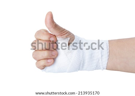 Thumb up showing by hand with white bandages isolated on white background - stock photo