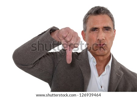 Thumbs down from a disapproving man - stock photo