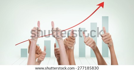 Thumbs raised and hands up against blue bar chart with red arrow