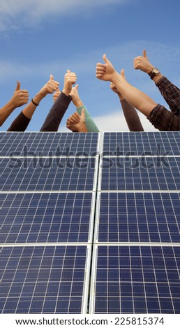 Thumbs up above solar panels