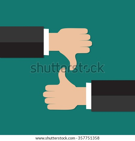 Thumbs up and thumbs down hand sign - stock photo