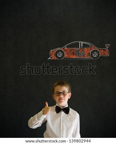 Thumbs up boy dressed up as business man with American racing fan car on blackboard background - stock photo
