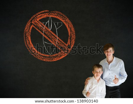 Thumbs up boy dressed up as business man with teacher man and politician no bombs war pacifist sign on blackboard background - stock photo