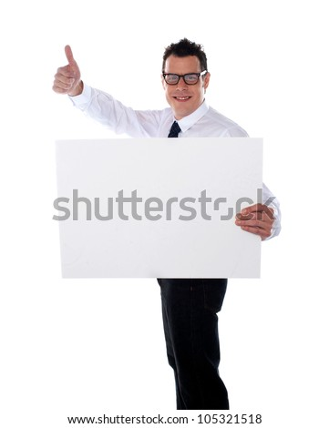 Thumbs up businessman holding banner ad isolated over white - stock photo
