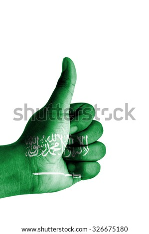 Thumbs up digitally composited on white background with Saudi Arabia flag - stock photo