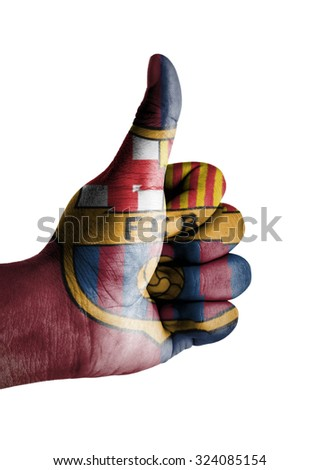 Thumbs up digitally compositing on with Barcelona Football Club flag - stock photo