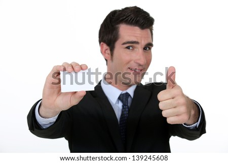 Thumbs up form n executive with blank business card - stock photo