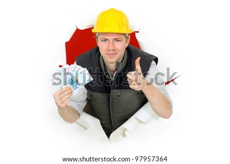Thumbs up from a builder holding cash - stock photo