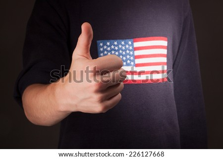 thumbs up gesture with american flag - stock photo