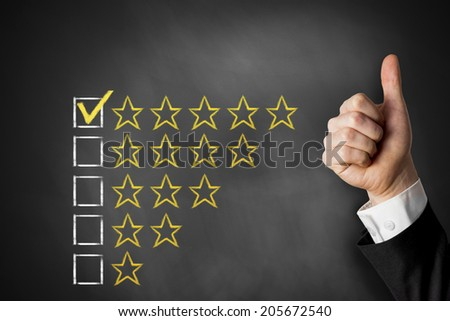 thumbs up golden rating stars checkbox on chalkboard