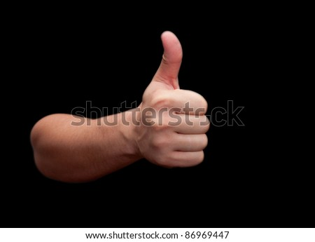 Thumbs up hand isolated on black background